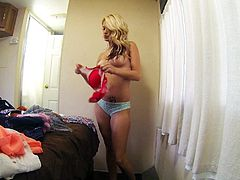 Long haired blonde girl Hope Harper with a lovely smile changes bra in front of the camera and shows her natural boobs. Do you like her sexy titties Nice girl