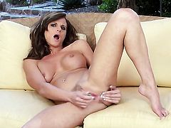 Daisy Lynn with massive breasts and hairless pussy satisfies her sexual needs alone in solo action