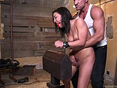 The nude slut in the video plays the kinky role of a vulnerable victim in this dominant guy's dirty fantasies. See her tied up, while clamps torture her sexy small tits. As her pretty mouth is stuffed with a ball gag, hands tied strongly, Marco gets to use her in every way he wants... Click and have fun!