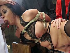 Kimmy is in a bit of a pickle with these priests. She's bound with ropes and getting fucked from behind by all of them. Her mouth gets no rest, either. She has to suck whoever isn't pounding her. The busty slut continues to slobber and get pumped by these horny clergymen. At least it's not boys.