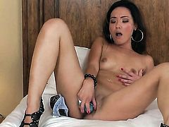 Incredibly sexy sex kitten Miko Sinz does her best to turn you on in solo action