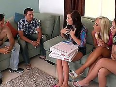 A pizza delivery guy is having group sex with a bunch of women. He really likes the time he is spending with them. The girls also kiss one another.