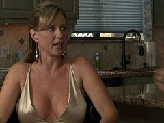 Busty babe in a sexy satin dress talks about sex and porn