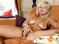 Marry Queen with huge jugs and bald snatch demonstrates her neat pussy hole in solo scene