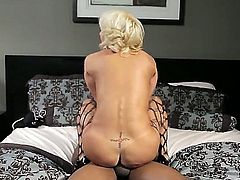 Tara Holiday is a delicious blonde that is spreading her legs for a black dude. He is penetrating her pussy with his meat stick in this interracial video. He really likes her.
