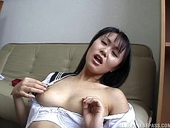 Moaning Asian finger fucks her hot box and cums hard