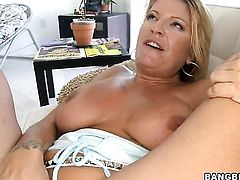 Blonde Robbye Bentley takes snake in her hands because her man is never enough