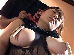 Her eyes are closed, but let's see if she can guess what her masked master is rubbing all over her big boobs. The huge breasted Japanese beauty has clothespins attached to her nipples and a feather, brushed against her supple skin.