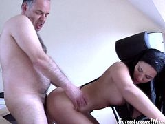 This lovely young tramp is after this old guy's money, but she genuinely likes him and is attracted to him physically. The little slut sucks his cock, until he's ready to get inside her, giving it to her hard from behind. He lays on his desk and then pumps her some more, going at it like it was his last.