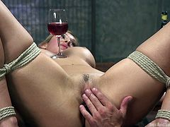 Deanna is all tied up, naked and at the mercy of her man, who is also her executor tonight. If she wants to be set free, she must be good and keep her balance. Just under her tits, a wine glass is set and it's full. She must take all his stimulation, both oral and digital, all while staying still.