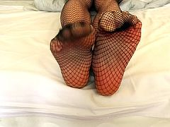 Sexy feet in fishnets