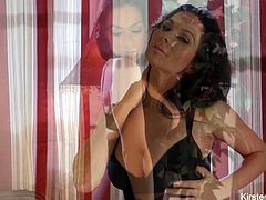 Kirsten Price shows off her body in tight black lingerie