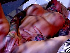Janine Lindemulder finds herself horny and takes toy in her twat