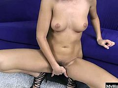 She plays with her pussy hair, letting it go between her fingers as she lifts her pussy lips and spreads them wide open. She plunges her fingers deep inside her hole and rubs her clit as she moans and groans. She stiffens up, closes her eyes and bites her lip as she makes herself cum hard