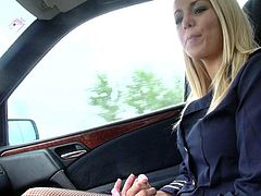 Beautiful long haired blonde Christen Courtney in blue stewardess uniform is a playful chick who has a good time playing with guys fat dick in his car. She gives sensual handjob before giving head.