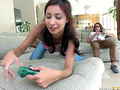 When a video game session with the guys isn't going her way, this brunette decides to take matters into her own hands. Using all the tools at her sexy disposal, she's about to make these guys lose the game. The boys get the better of her in the end though and get their much-deserved revenge!