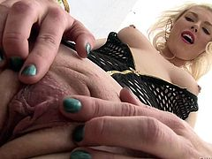 Blonde babe Ella Nova in black fishnet outfit flaunts her big booty and spreads her pussy lips outdoors. Then hot guy spreads her butt cheeks and she put her flexy asshole on display.