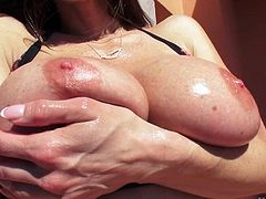 Gorgeous MILF brunette Kendra Lust flaunts her huge boobs and perfect bubble butt in the sun. She exposes her assets and then gets her slit tongue fucked from behind by Mick Blue.