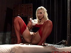 Beautiful blonde cougar with a fabulous body torturing a stranger
