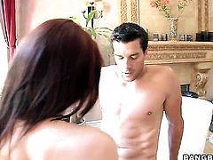 Brunette Amy Reid has fire in her eyes while blowing mans rock hard love wand