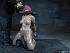 Penny is restrained with her arms behind her and her head secured in a board, attached to a post. She is whipped hard, yet pleasured by this electric machine, that is buzzing against her pussy. She cries out a little after each strike of the whip, but she still gets close to orgasm with that stimulation.