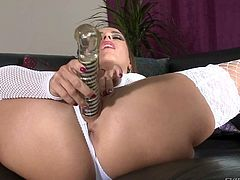 Charming brunette Mea Melone in snow white lingerie opens her legs and to drill her cunt with her new big glass dildo. Sexy babe in stockings and panties fingers her tight asshole at the same time.