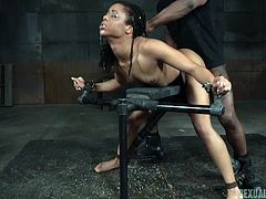 A hot ebony lady, who is completely naked, gets awfully used by a dominant partner, who restrained her in a kinky bondage device. Watch slutty Kira, obediently sucking the guy's cock. Don't miss the hardcore spicy scenes!