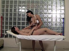 Topless brunette Candy Sweet with natural tits and long legs gets massaged by busty Zafira. Lovely girl gets her nice body rubbed and then they have sensual lesbian sex.