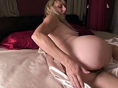 Hairy mature beauty naked on satin sheets