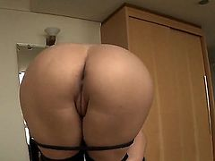 Latina removes her panties and pants to make her huge ass visible. She is getting pinched there and she exposes her ass gape. She is in a playful mood.