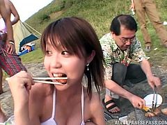 These naughty girls came to the seaside near Yokosuka to have a fun time. They frolic in the bikinis, drink beer and have some grilled food. They humiliated their male friend, by pouring beer on his cock, jacking him off and pissing in his mouth.