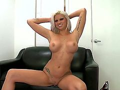 Deadra Dee is filmed as she is walking around here. She is dropping pieces of her clothing until there is nothing left but her two large boobs that are staring at us. Solo girl.