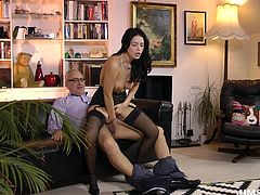Slutty Lara has brought sexy Ava home, to entertain her horny husband. See this cute brunette babe, undressing for naughty Jim. Wearing high heels and kinky stockings, sweet Ava conquers the man with her hot looks. Watch her sucking dick with fervor and riding it!