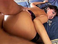 Anastasia II is doing some anal action in this video. She is getting an anal gangbang. A cock is going deep inside her throat as well. She has a perfect backside.