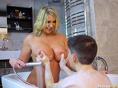 I could not take my eyes off Leigh's breasts, ever sinced she moved in with my Dad. She walked in to me, when I was taking a bath. I was embarassed. But surprisingly, she didn't leave. She said, she can help me clean up. I let her rub my body clean... and something else. I was shocked in a good way.