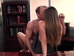 Slutty slim brunette secretary lures boss to be fucked right on the table
