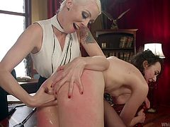 Lorelei knows exactly how to make her sexual slave scream of both pain and pleasure... First of all, the tattooed blonde mistress deeply fingers slutty Lilith. The curly bitch seems to enjoy it as, between moans of ecstasy, she often smiles sensually. Enjoy these inciting lesbian scenario!