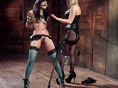 This blonde dominatrix knows how to make her sex slave behave! She ties up and gags a tight-bodied Asian chick, so she can explore her curves as she pleases. When she gets tired of this, she shoves her wet twat in her slave's face, to make her pleasure her mistress.