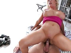Huge tits blonde spreads her legs