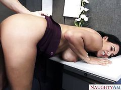 Huge tits bounce in an office