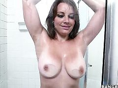 Solo girl plays with her large boobs