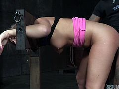 Maddy is put in the stocks, but not because she's accused of being a witch. It's because the bitch needs to get broken sexually, and Jack is an expert at that. Her moans and screams are dulled a bit by the ball gag, as she gets hit hard from behind by Jack's big cock. The bound slut gets fingered too.