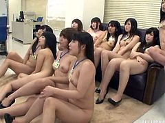 All the female employees are nude, except for their name tags. The boss has gathered his harem in his office and they get ready to fuck him. They crawl all over him and lick his skin. He has multiple women on his cock, but it is too much. The male employees need to fuck some of these sluts, too.