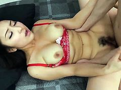 Busty Asian spreads her legs