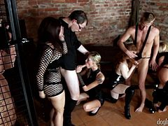 I really wanted to join in on this hot orgy, but I was punished and locked in the cage. At least I got to watch, as the sexy sluts got fucked hard and sucked cock. The skinny blonde took it hard and deep, while the redhead and brunette shared a dick.