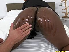 Mick has this hot black slut in his bed. She is a wild one, who loves interracial sex. The hot black bitch takes her man's white cock and sticks it in between her natural boobs. She will make him cum with her lips and tongue.