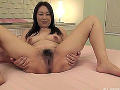 Mature sluts like Reiko, always fuck best. Her natural boobs look wonderful and so suckable. The hot mature lady opens up her legs, to show off her hairy bush. She needs to be fucked now. Some fingering will get her ready for cock.