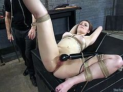 Nora is the sexy subject of domination today. Her executor drills her tight asshole, making her stream. Bound with ropes, she's tied to the table with her legs spread wide. He stimulates her pussy now with an electric vibrator. He makes her really scream, after he ties it to her leg, so it stays in place.