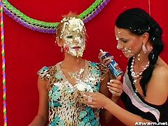 Food fight calls many things to memory, like two hot babes at a table full of desserts. The pair of ladies then smear each other all over with the selection of whipped cream and icing-heavy sweets. Then they wrestle each other.