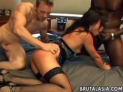 The slut is an Asian bitch who loves to be fucked in both her holes. The big cocks are clocking her and she is loosing her mind as she gets overwhelmed. So damn hot.